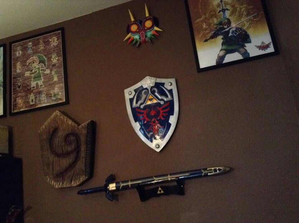 Prop wall in progress. working on the mirror shield right now other than that my hylian and deku shield kicks butt.  Working on Zora, Deku, and Goron mask as well.