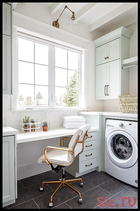 Multi-purpose space brings together a laundry room and home office with stunning light gray cabinets a white floating desk and slate floor tiles  Multi-purpose space brings together a laundry room and home office with stunning light gray cabinets a white floating desk and slate floor tiles  Jennifer Smith Save Images Jennifer Smith Multi-purpose space brings together a laundry room and home office with stunni #brings #cabinets #floating #floor #laundry #laundryroomcountertop #light #multipurpose #graylaundryrooms