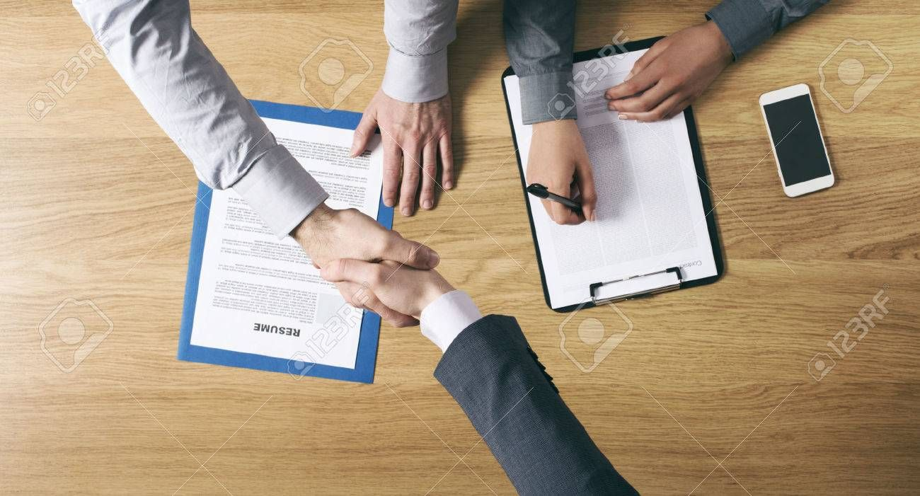 Employer hiring and giving an handshake to the candidate