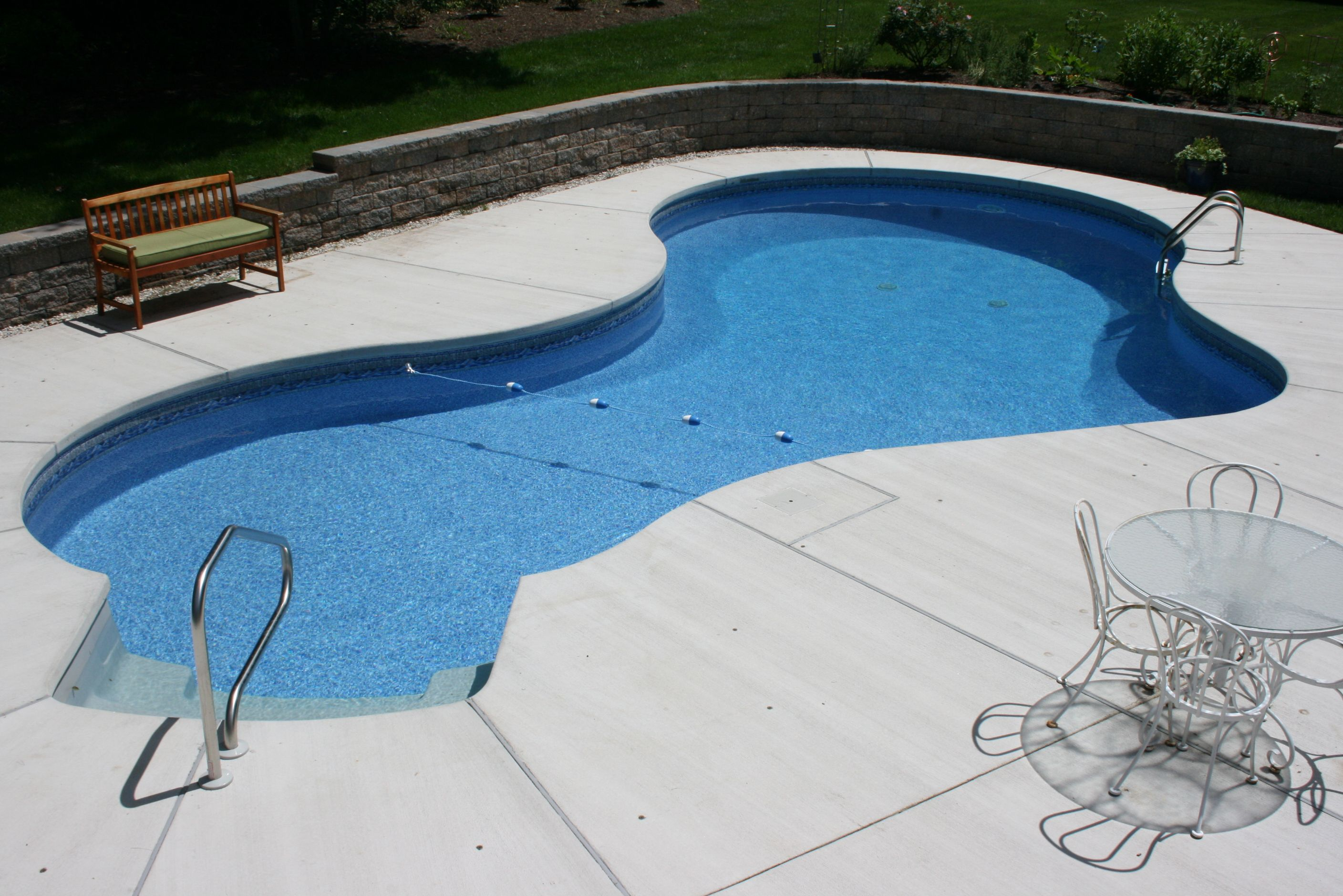 A Mountain Lake Style Pool Featuring Brushed Concrete Decking
