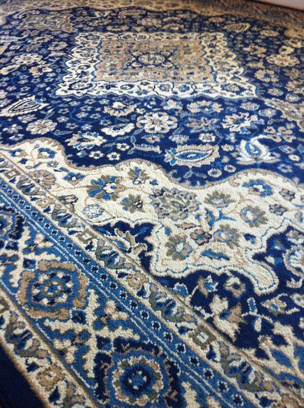 blue area rug in traditional style. this would look good with our