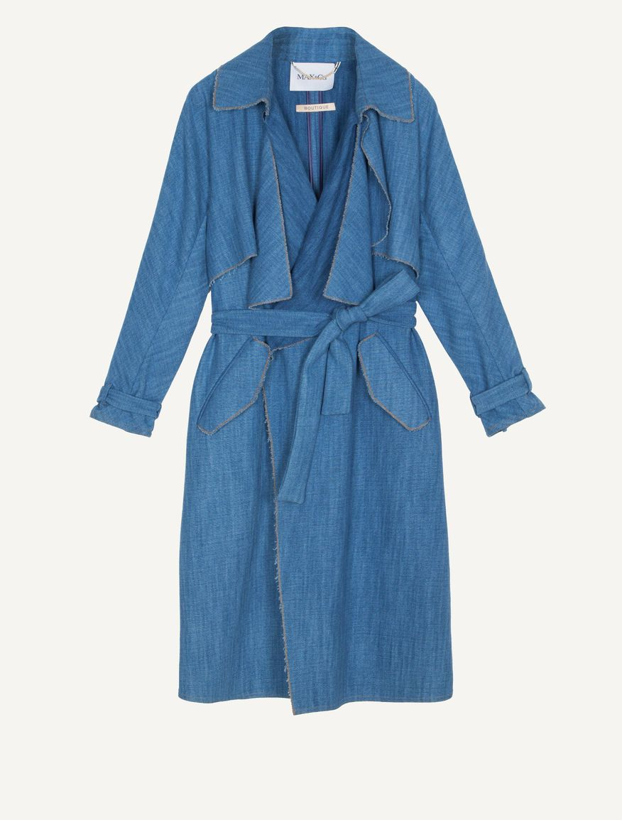 MAX&Co. - Denim-effect gabardine trench coat, Light Blue - MAX&Co. boutique garment. Cotton gabardine trench coat. Denim-look fabric, indigo yarn dyed. Washed look. Straight cut, with belt tied at the waist. Soft styling. Knee length. Shirt collar. Wide and soft lapels. Double-breasted with no fasteners. Gun flap in front. Double welt pockets with flap. Long kimono sleeves with strap cuffs. Raw-cut edges with contrasting stitching. Hanging chain. Unlined, internal seams trimmed with ribbon…
