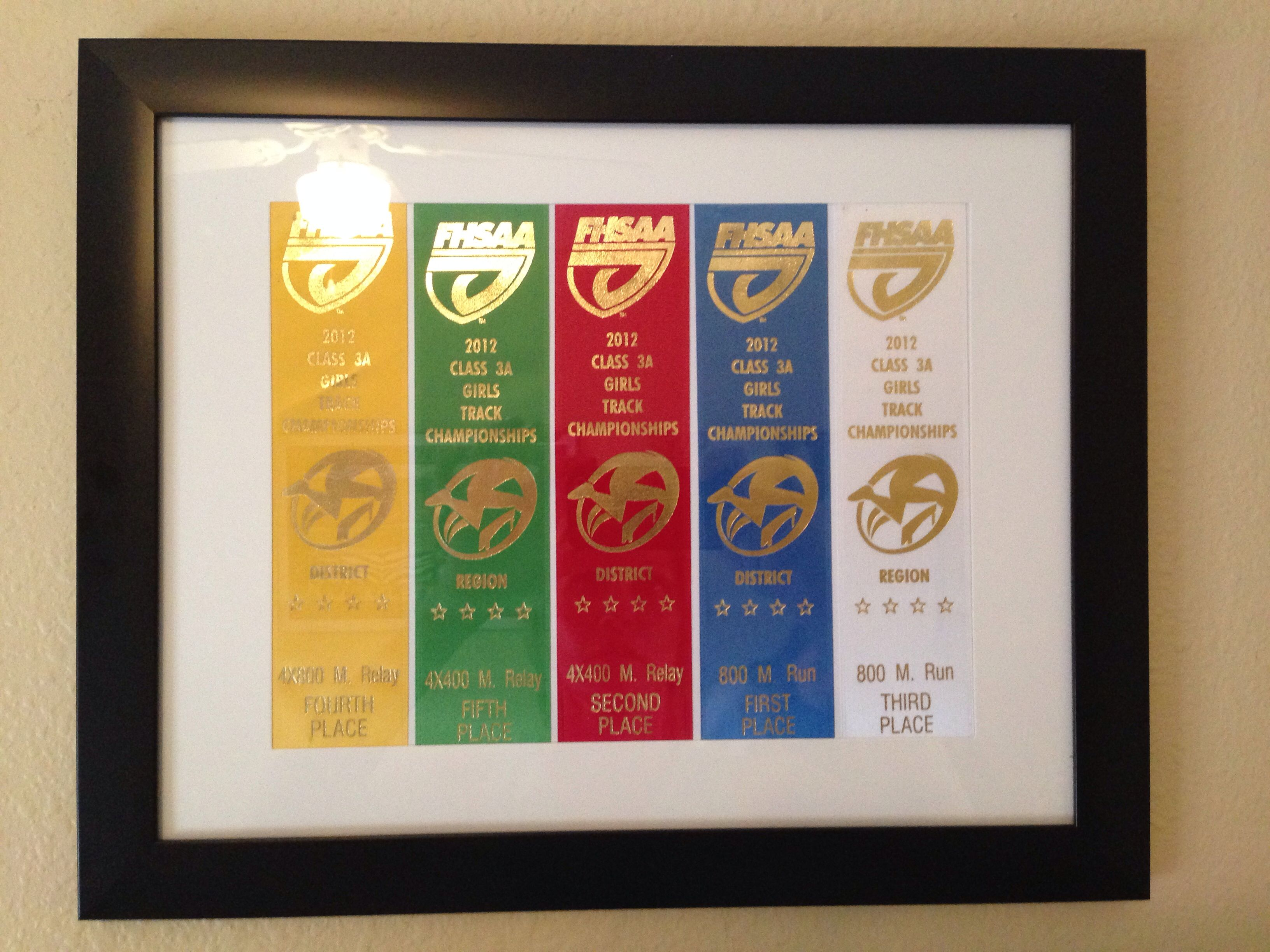 Track ribbons displayed in a frame. They fit perfectly in a matted ...