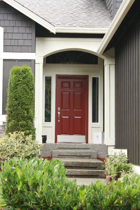 Grey House With Red Door Sidelights Are White Trimmed