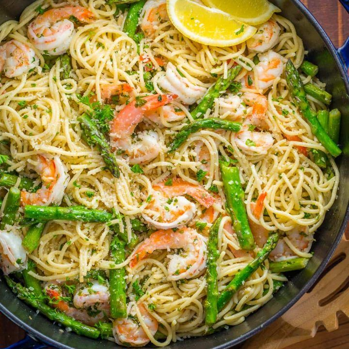 Shrimp Scampi Pasta with Asparagus has a lemon garlic and herb sauce that packs so much fresh and amazing flavor. A 30 minute shrimp scampi pasta recipe! | natashaskitchen.com #shrimpscampi