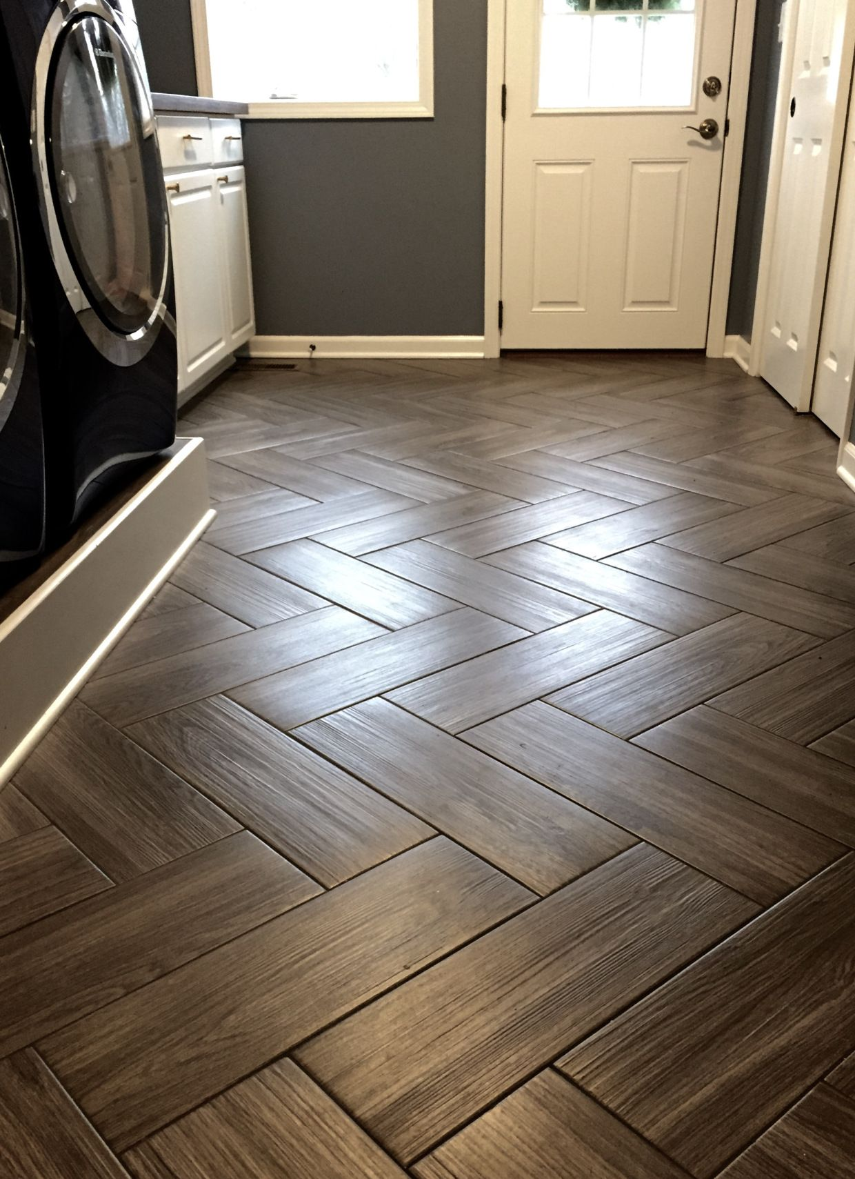 Gray wood grain tile in herringbone pattern