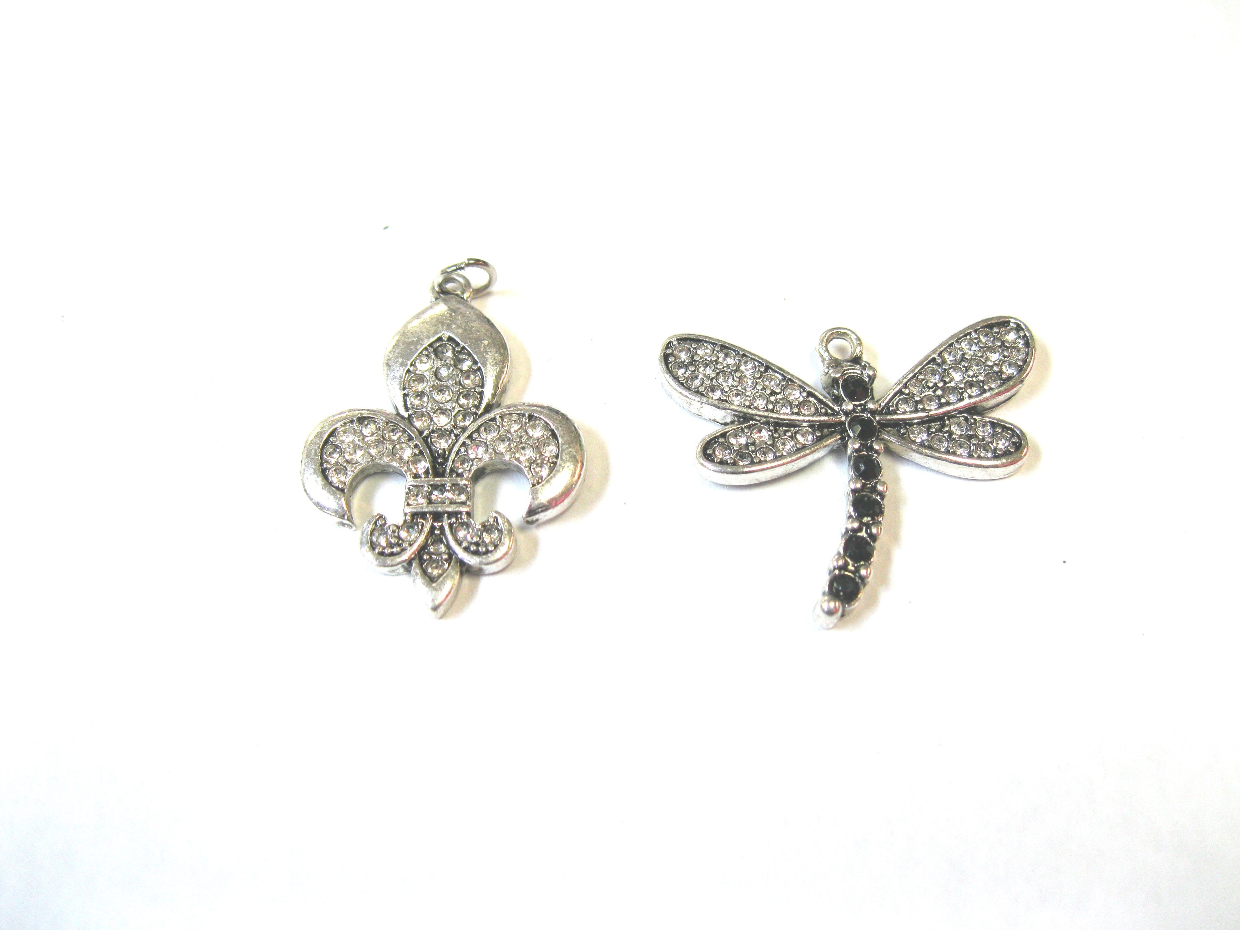 Mosquito/ Fleur de Lis Crystal Charms. Contact us for details or to order at alice@atgtexas.com