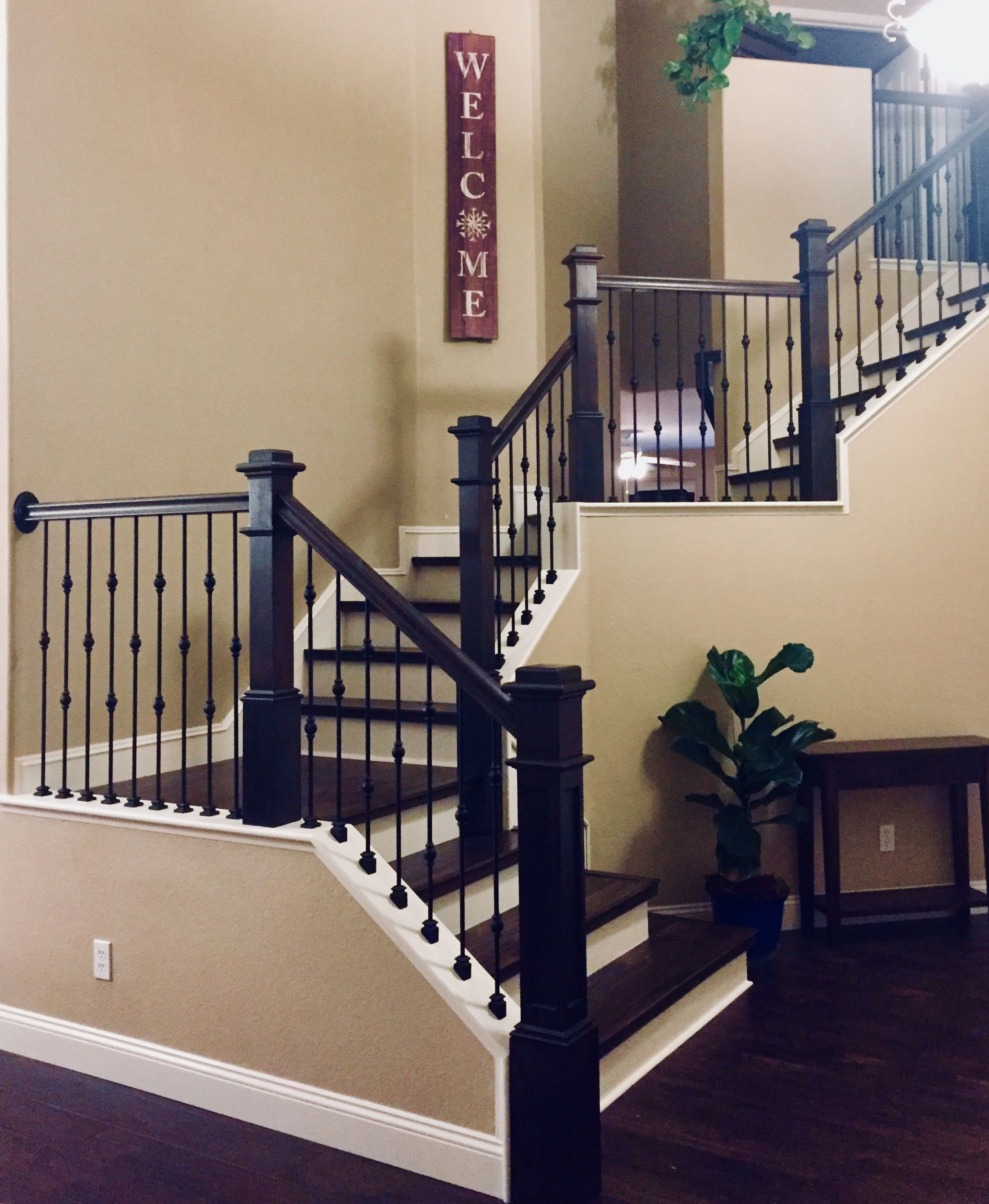 Classic Staircase With Ebony Stained Newel Posts, Iron