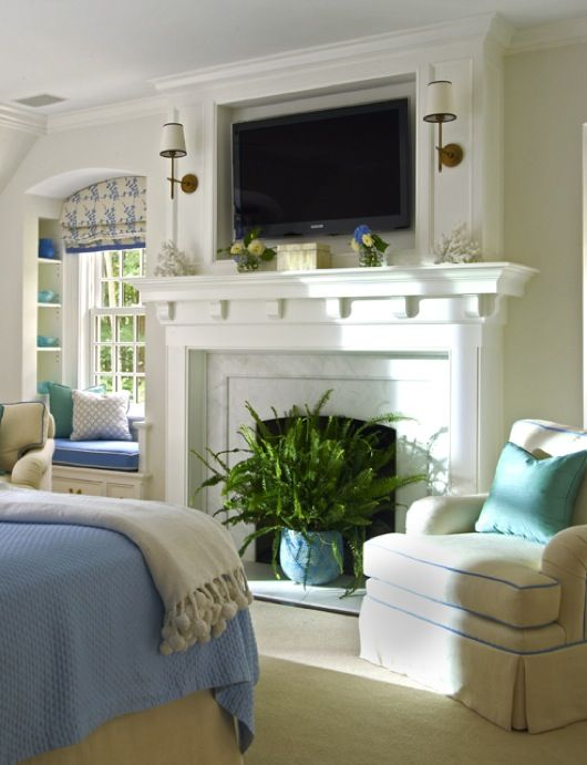Blue and white with turquoise accent. Love the fireplace and scones, the window seat.
