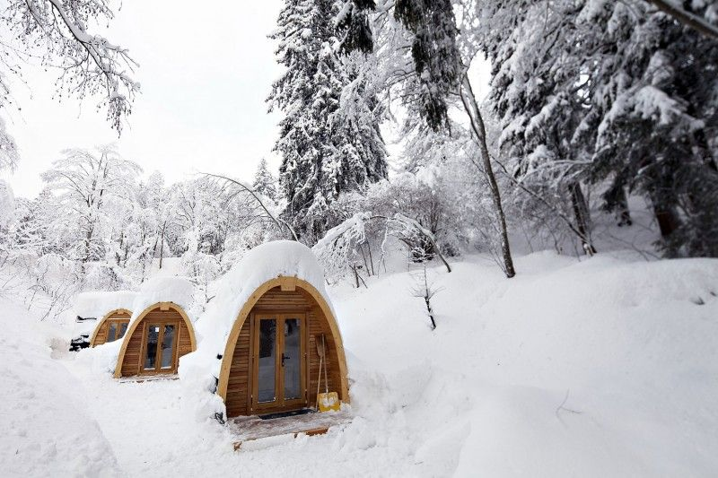 """PODhotel by POD Design.  """"New York City-based studio POD Design+Media has designed the PODhouse, a sustainable prefab module built by Robust Outdoor Brands that can be used as a 'backyard office or as secret holiday hideaway.' Located in Flims, Switzerland, PODhotel is an eco POD hotel made of three very well insulated PODhouses to provide affordable accommodation and maximum comfort during even the most extreme weather."""""""
