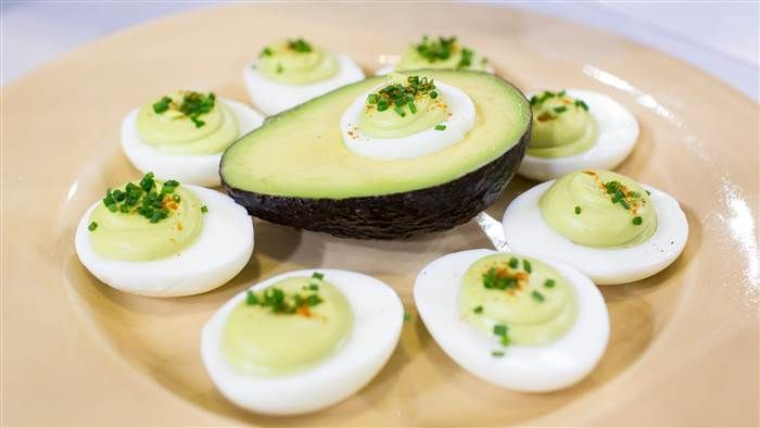 Give deviled eggs a tasty boost with avocado, cayenne and chives