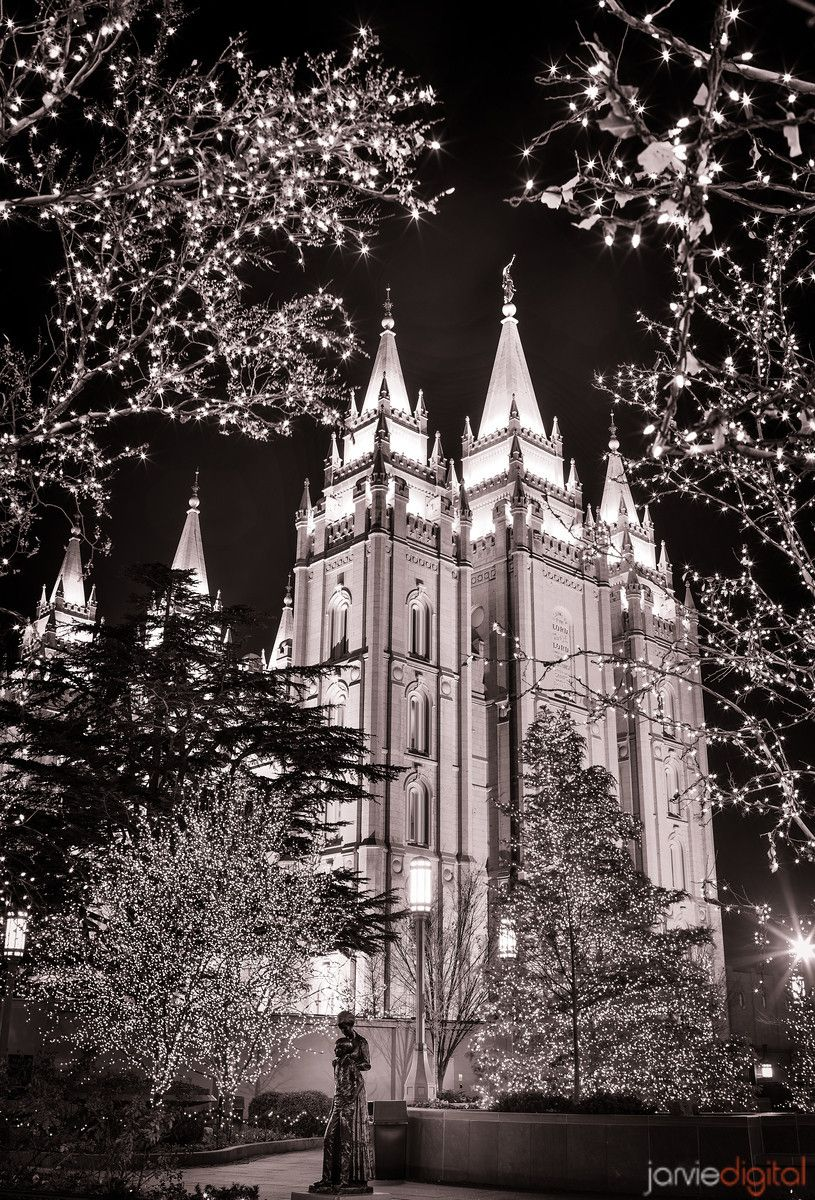 a black and white image of Salt Lake City Temple at christmas time ...