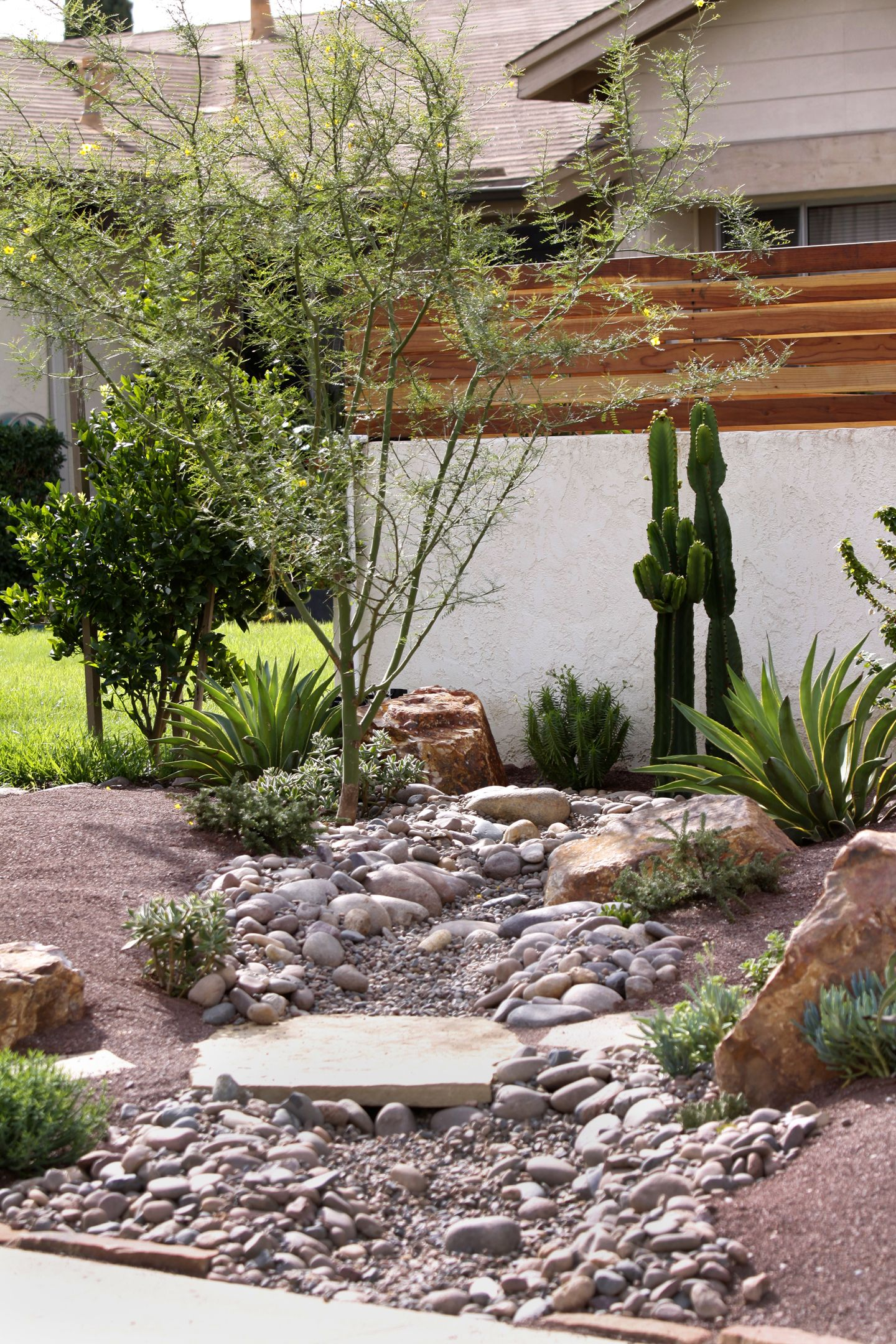 Dry creek bed or dry stream bed design idea by singing for Dry landscape design
