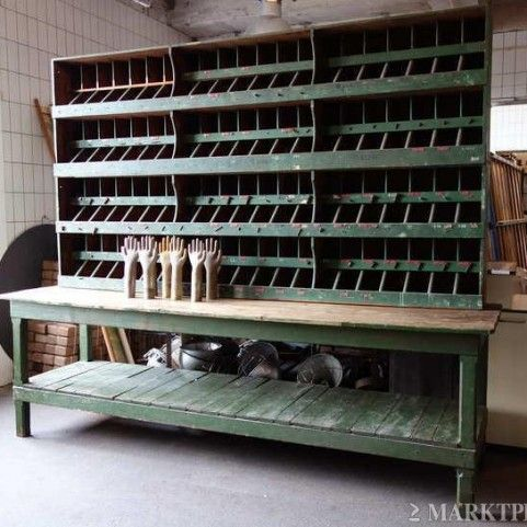 Vintage industrial workbench with cubbies.  Going to have to get something like this some day!   ...minus the creepy hands