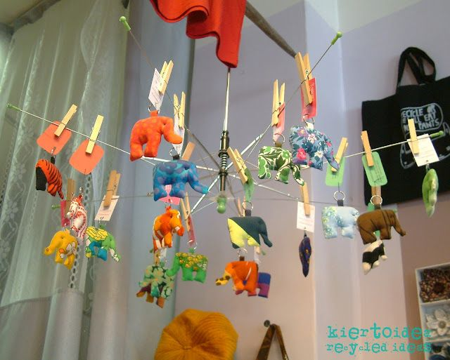 umbrella hanging mobile could use in the class room for hanging craft projects.