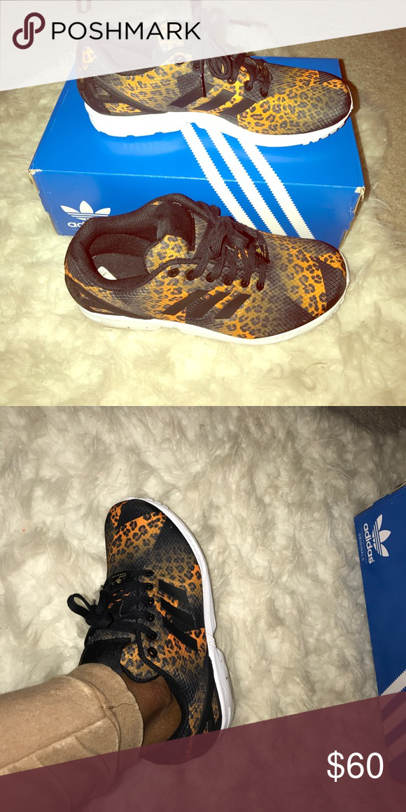 new arrivals be1f0 8c81c Leopard Adidas Black and orange leopard print adidas! ZX Flux! Men s 7, women s  9. Worn 2 times! Still like new! Comes with box adidas Shoes Sneakers