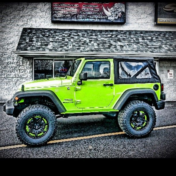 Lime Green Jeep Wrangler sprayed at Rhino Linings of DE #jeep #wrangler www.rhinoliningsofoc.com