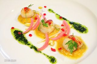 Pan Seared Scallops served on a bed of Butternut Squash Puree with cilantro oil by Steven Dolby