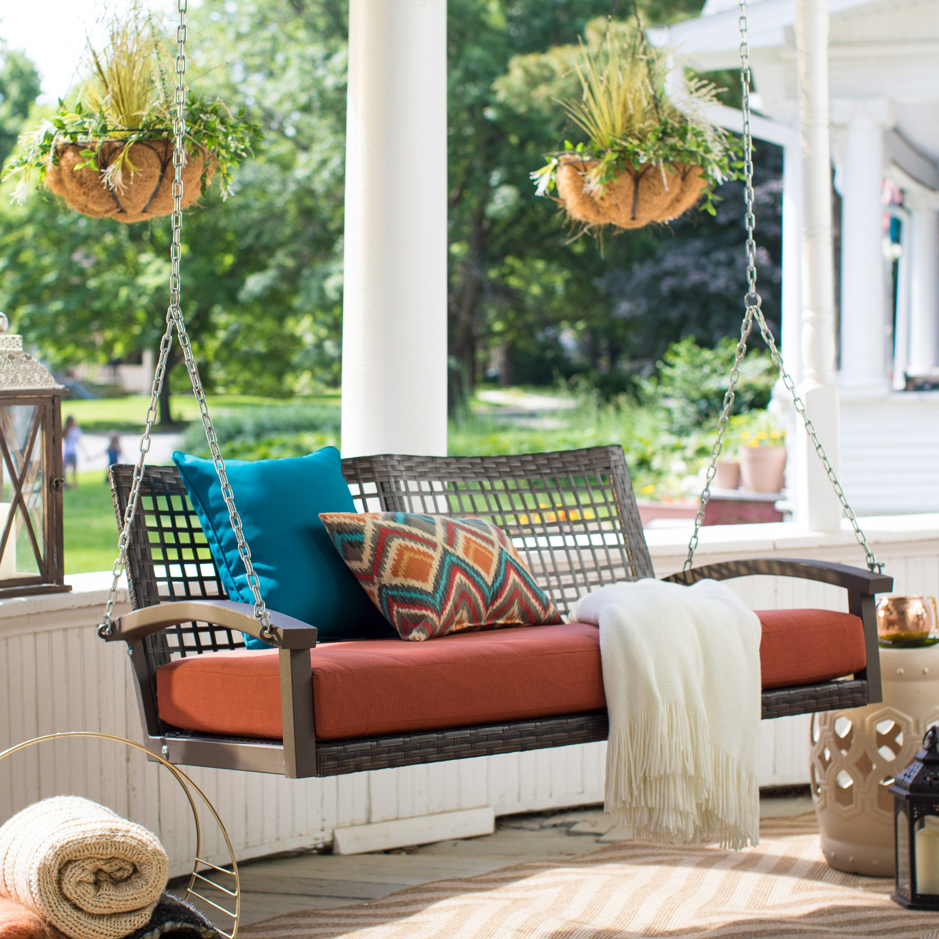 Belham living bigsby resin wicker porch swing with cushion from