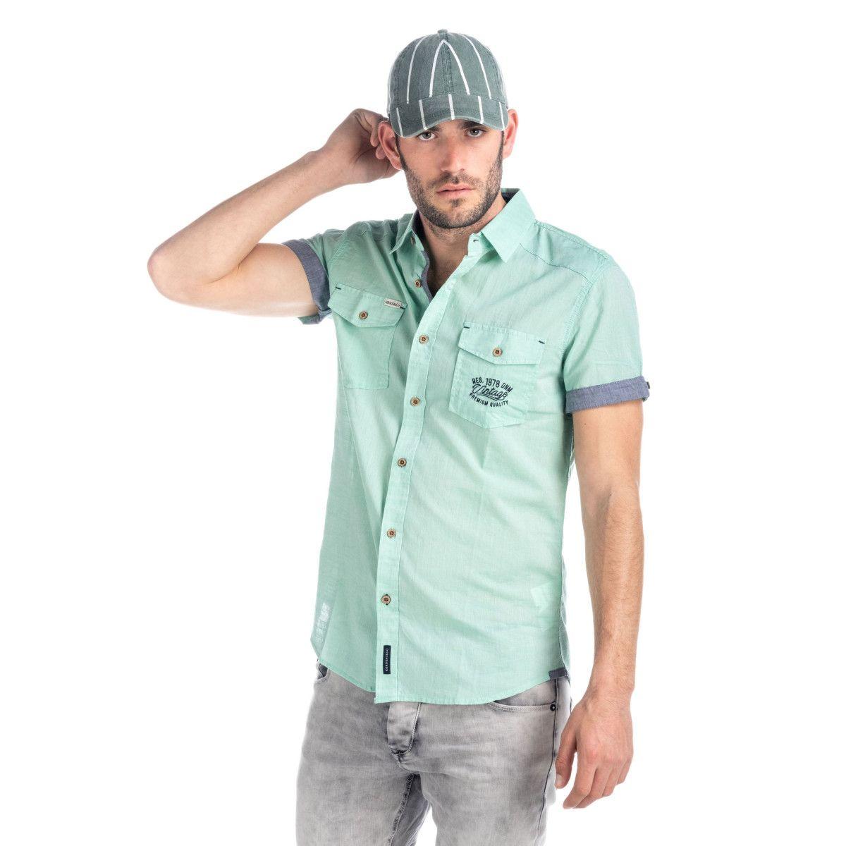 2d4940aa12 Camisa de lino manga corta con dos bolsillos delanteros y detalles de  tejido a contraste.