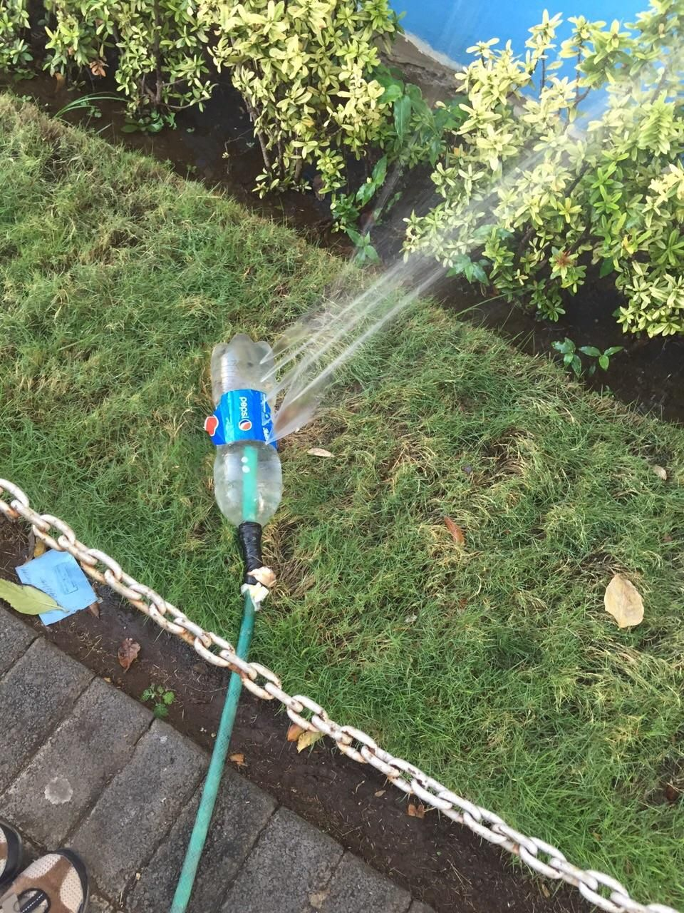 You can use a plastic bottle to make a DIY sprinkler in a pinch.