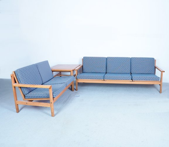 1960s Danish design sofa set by Laboremus Viborg.A 2 and 3 seater with corner table made of solid oak and loose seat and back cushions.Beautiful sleek minimalist design that fits in a modern as well as in a vintage interior.The cushions have new cushion covers with a fabric with black and white motif and a zipper.the sofas are demontable.Sizes: W190/ 133 x H75 x D76 cm. seatheight 40 cm. table H55 x B+D71 cm.
