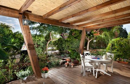 Genial Woode Deck Flooring And White Wooden Round Table Set Inside Wooden Gazebo  With Bamboo Roof In Tropical Patio Design Ideas Patio Cover To Cover Your  Patio