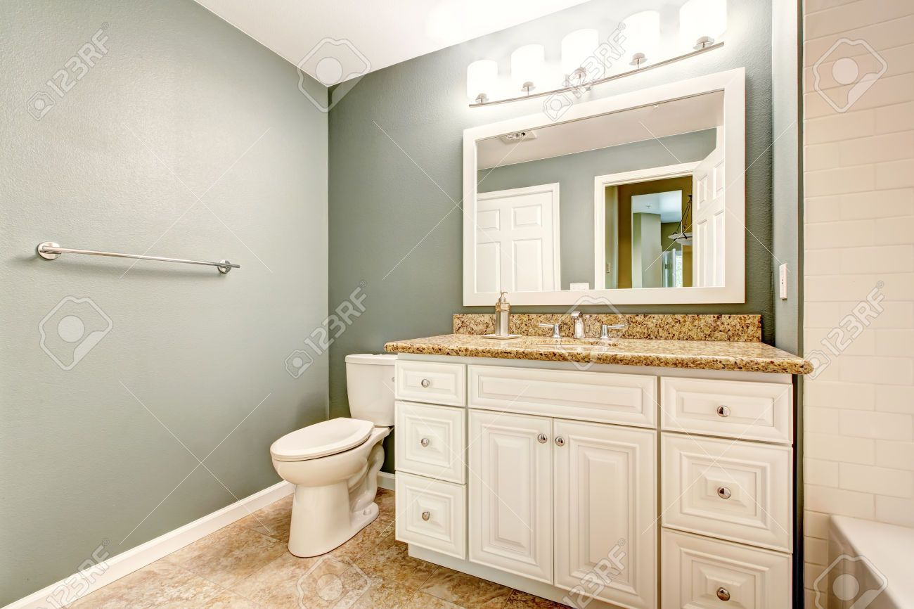 31306093-White-bathroom-vanity-cabinet-with-granite-top-and-mirror ...