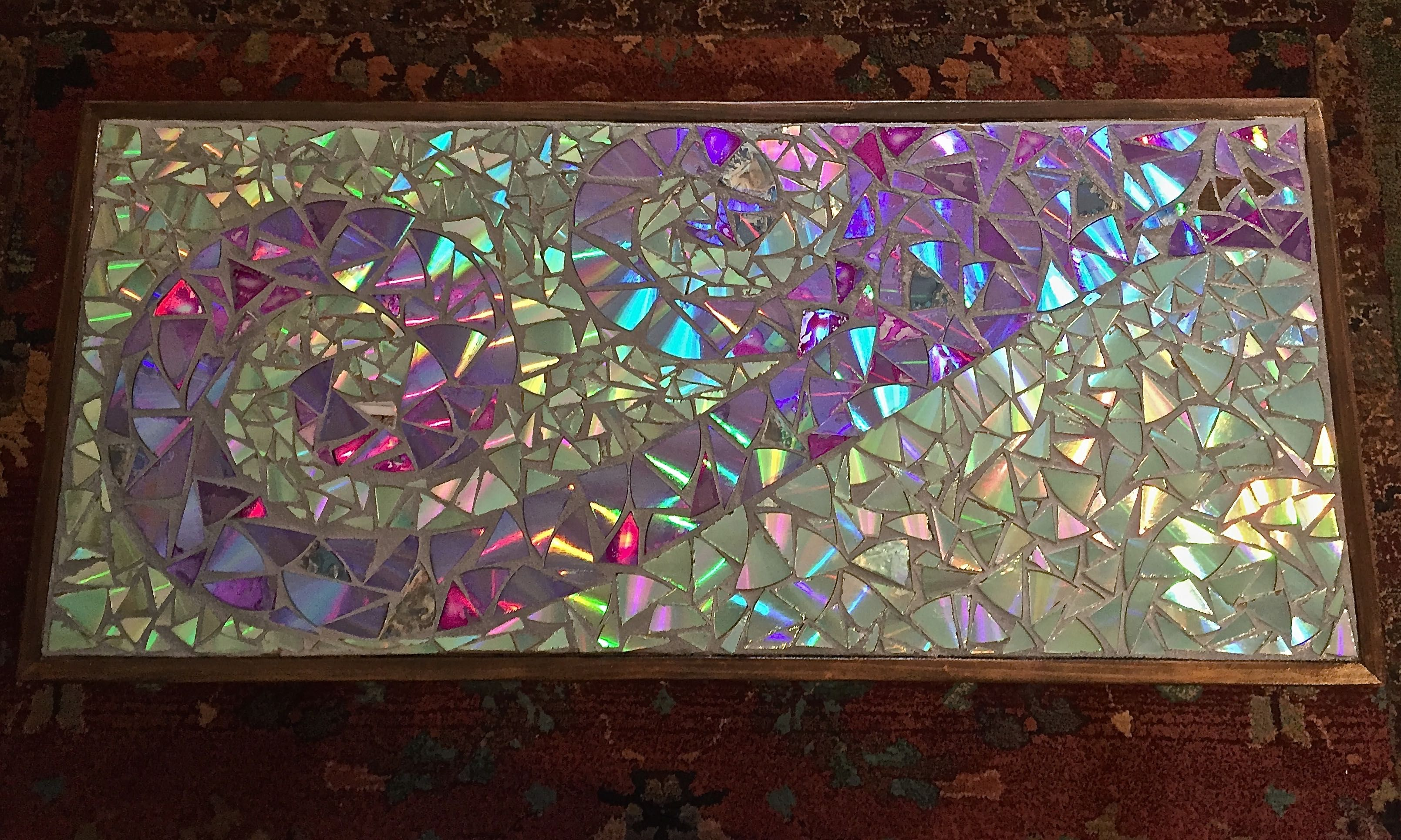 The Upper Elementary class used cut pieces of CDs and DVDs to make this mosaic table.