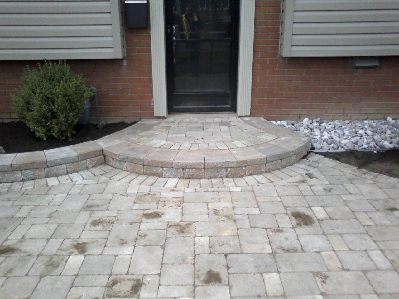 Great looking front entrance the circular step creates a welcoming feel. http://www.facebook.com/LakeridgeContracting