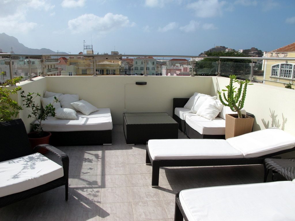 Terrace Design On The Rooftop Home With Table And Chair Colored Black  Combination White