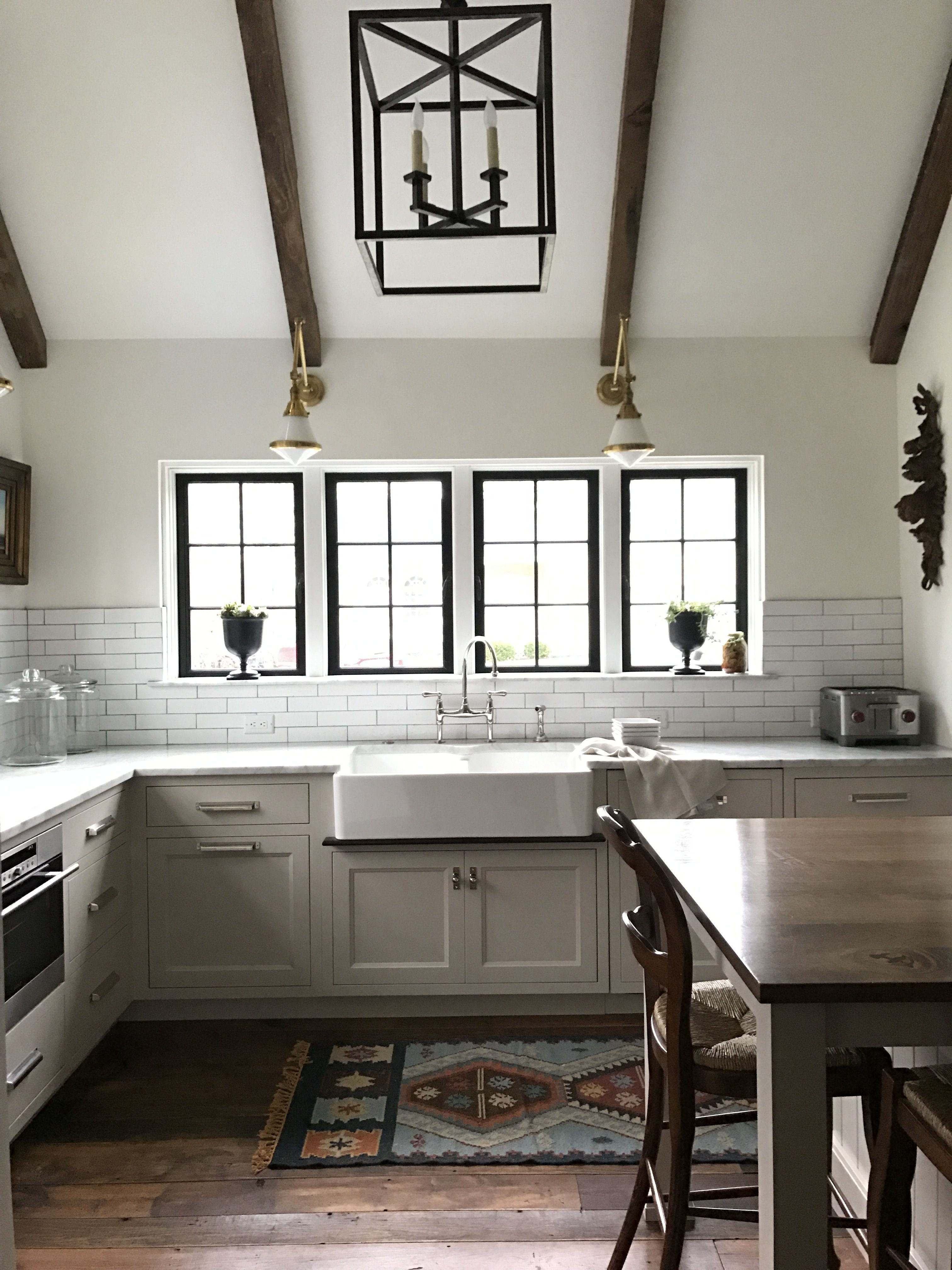english kitchen with beams vaulted ceiling casement windows apron front farm sink white on farmhouse kitchen no upper cabinets id=39805