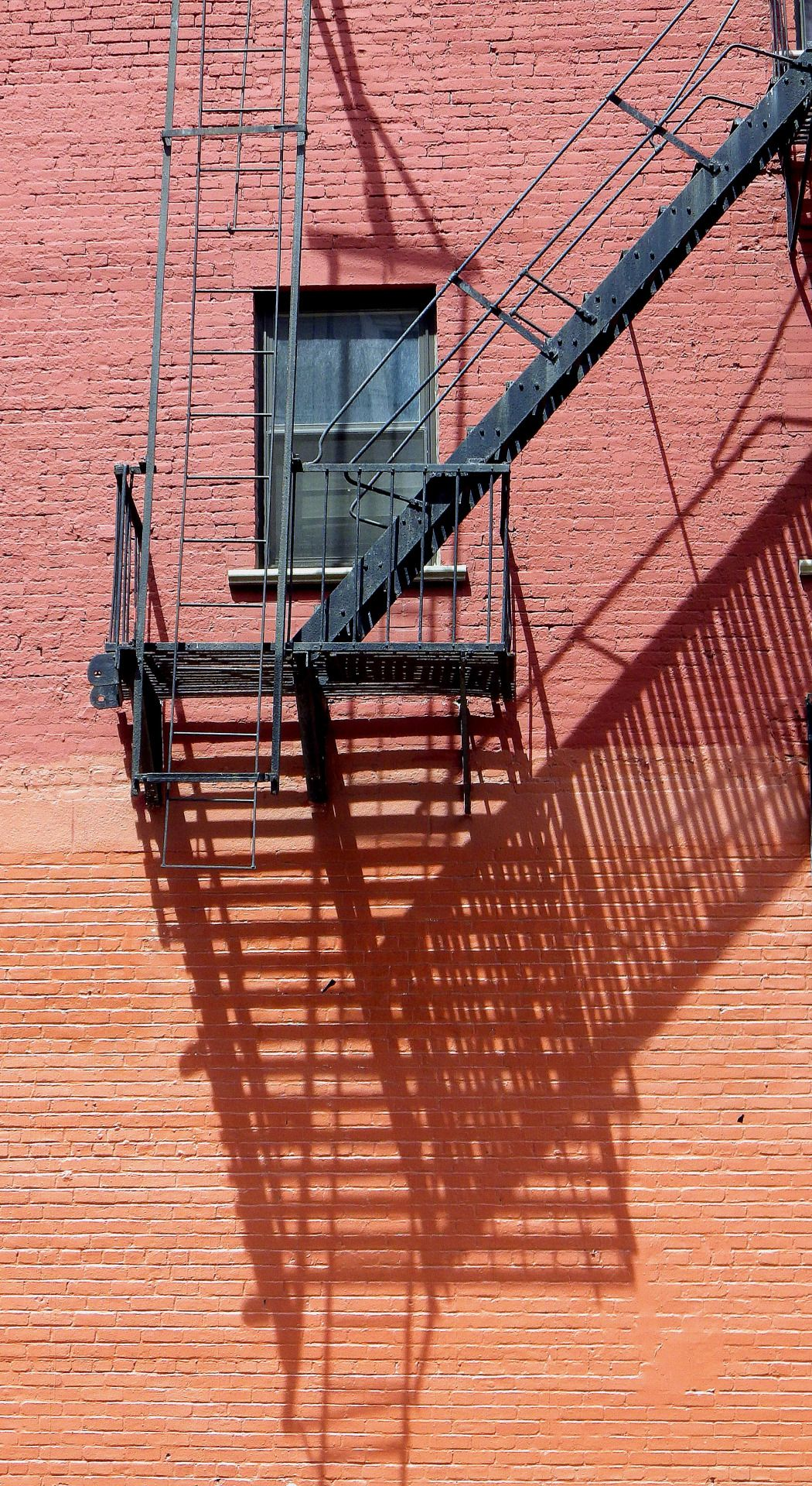 wanderingnewyork:A fire escape and its shadow on the Lower East Side