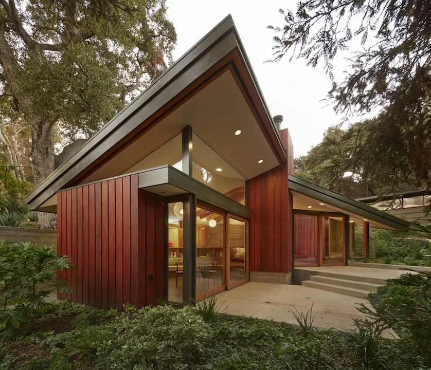 A Renovation Full Of Clever Design Flourishes Mid Century Home In 2020 Mid Century House Building Design Contemporary House Design