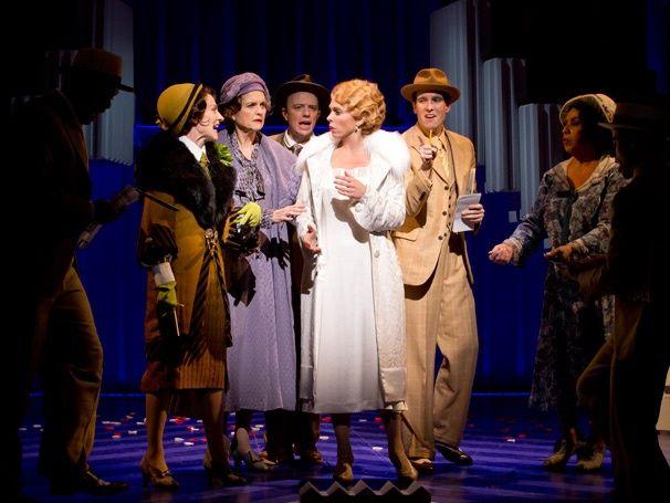 Carolee Carmello as Aimee Semple McPherson and the cast of Scandalous