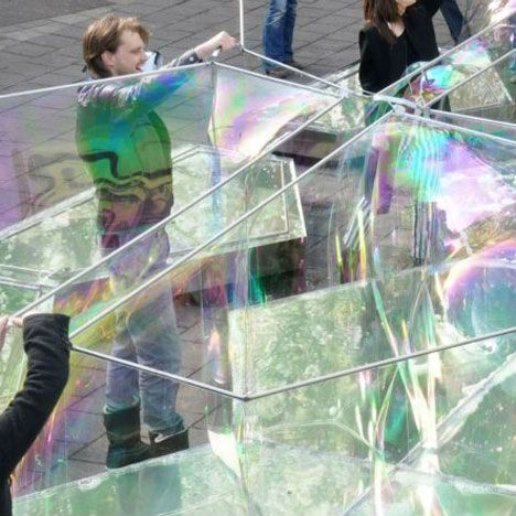 Temporary bubbletecture! The interactive Bubble Building pavilion by Dutch firm DUS Architects, where visitors lift metal frames of various shapes and sizes out of soapy steel pools.