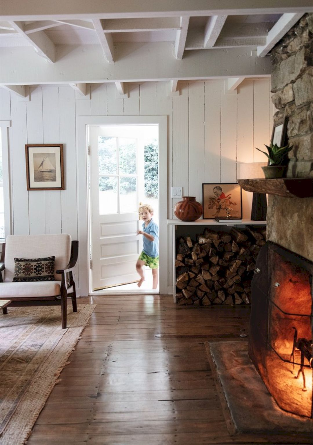 Photo of Mountain Cottage: An English Cottage with Simple Traditional Interior and A Lot of Frames