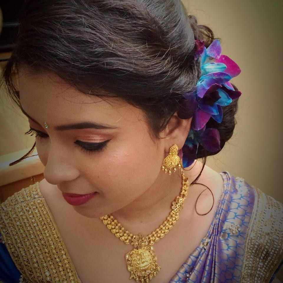 indian bride's bridal reception updo by swank studio. find us at