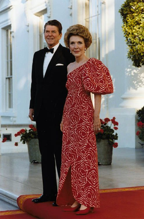 Not a fan of the dress-but it takes confidence to wear it. What a dapper-looking couple. One of my all-time favorite Presidents.