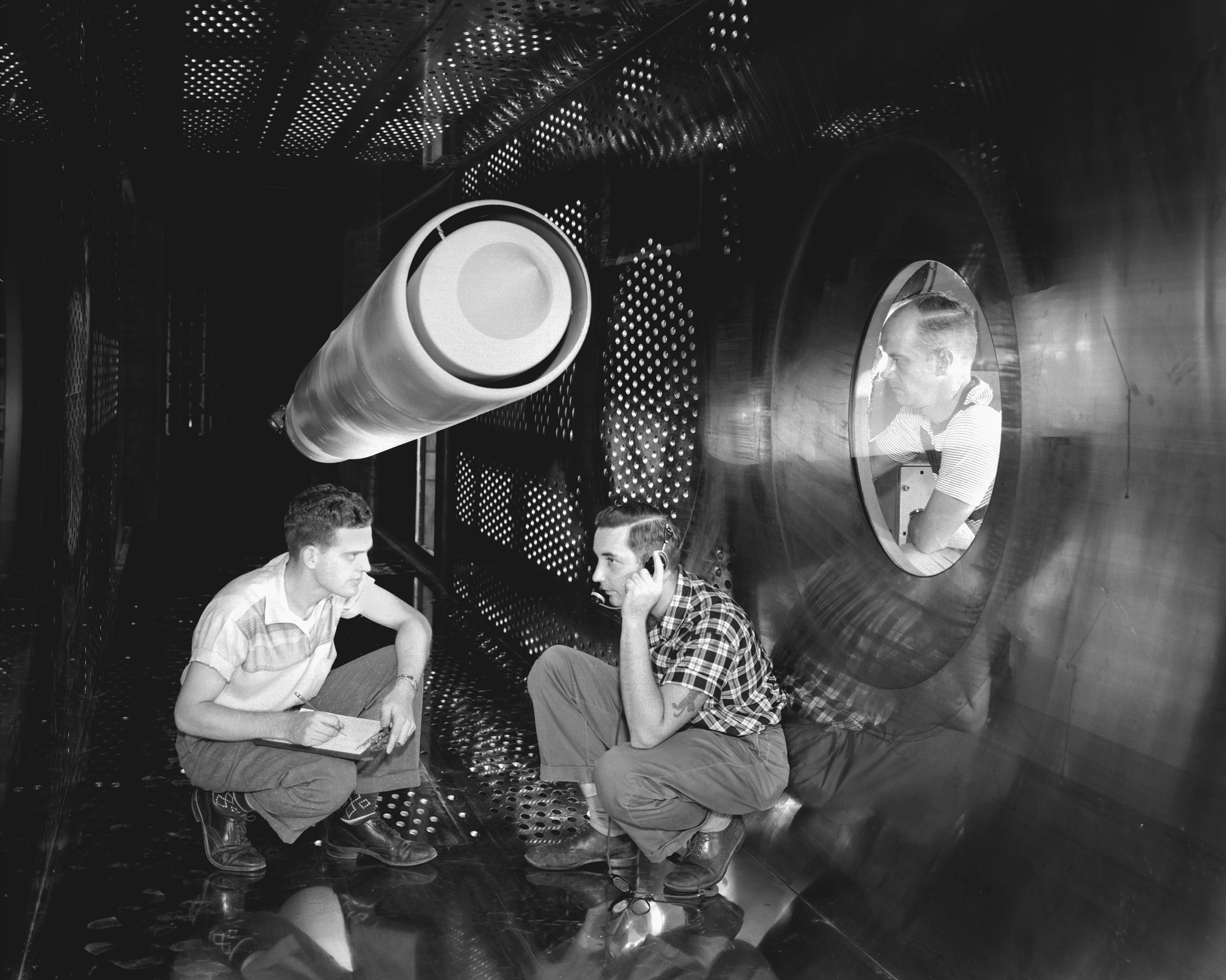 8ft x 6ft Supersonic Wind Tunnel Test-Section showing changes made in Stainless Steel walls with 17 inch inlet model installation. The model is the ACN Nozzle model used for aircraft engines. The Supersonic Wind Tunnel is located in the Lewis Flight Propulsion Laboratory, now John H. Glenn Research Center.