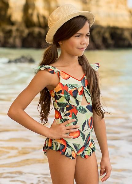 ddc6e09000 With ruffled straps and a flounced trim, the Marina swimsuit will be a must  have one-piece! A soft bow detail and a cutout at the front create the  perfect ...