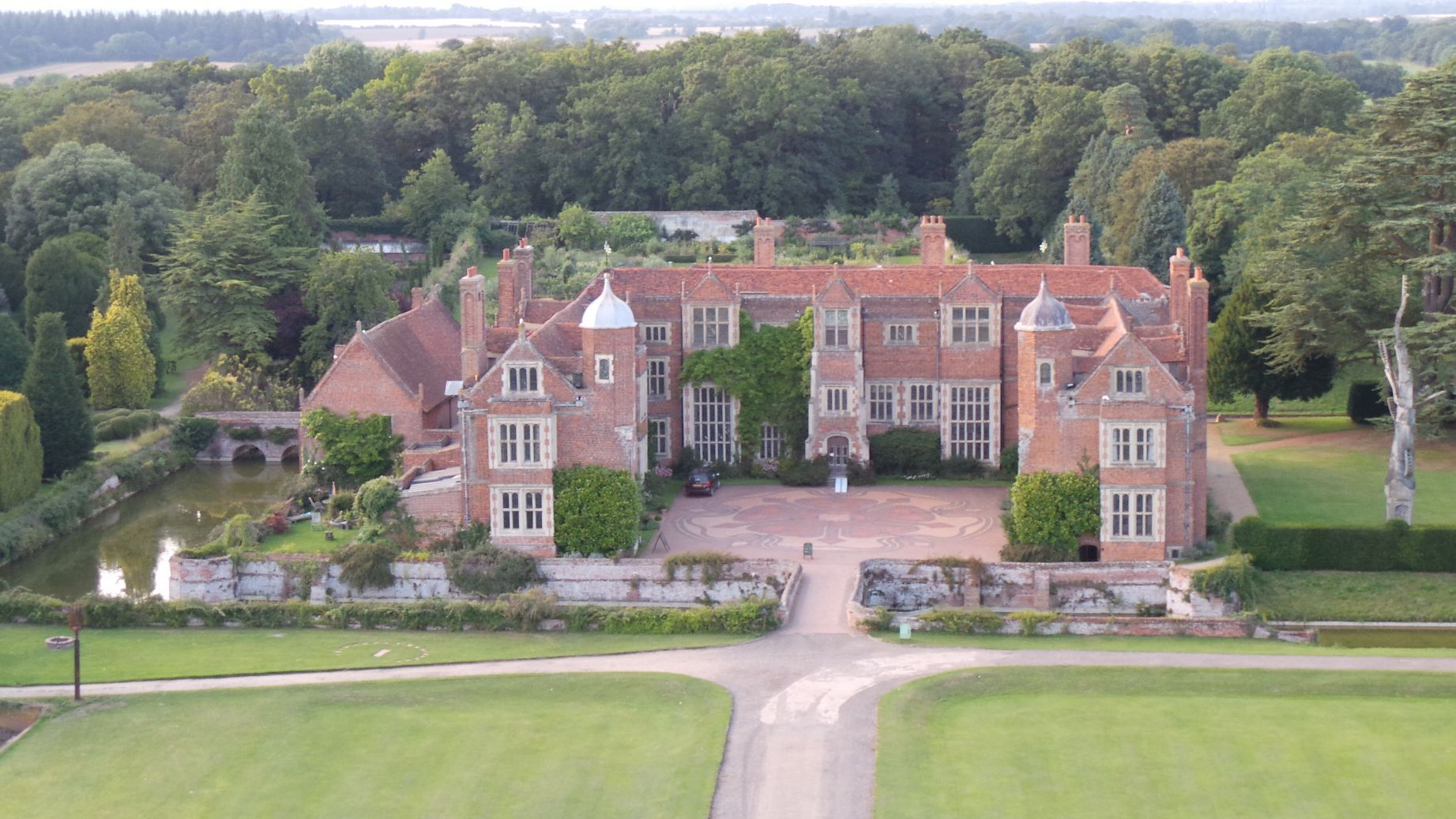 Kentwell Hall Is A Stately Home In Suffolk With A Rare Breed Farm And Gardens Tudor Reenactments Also Take P Wedding Venues Stately Home English Country House