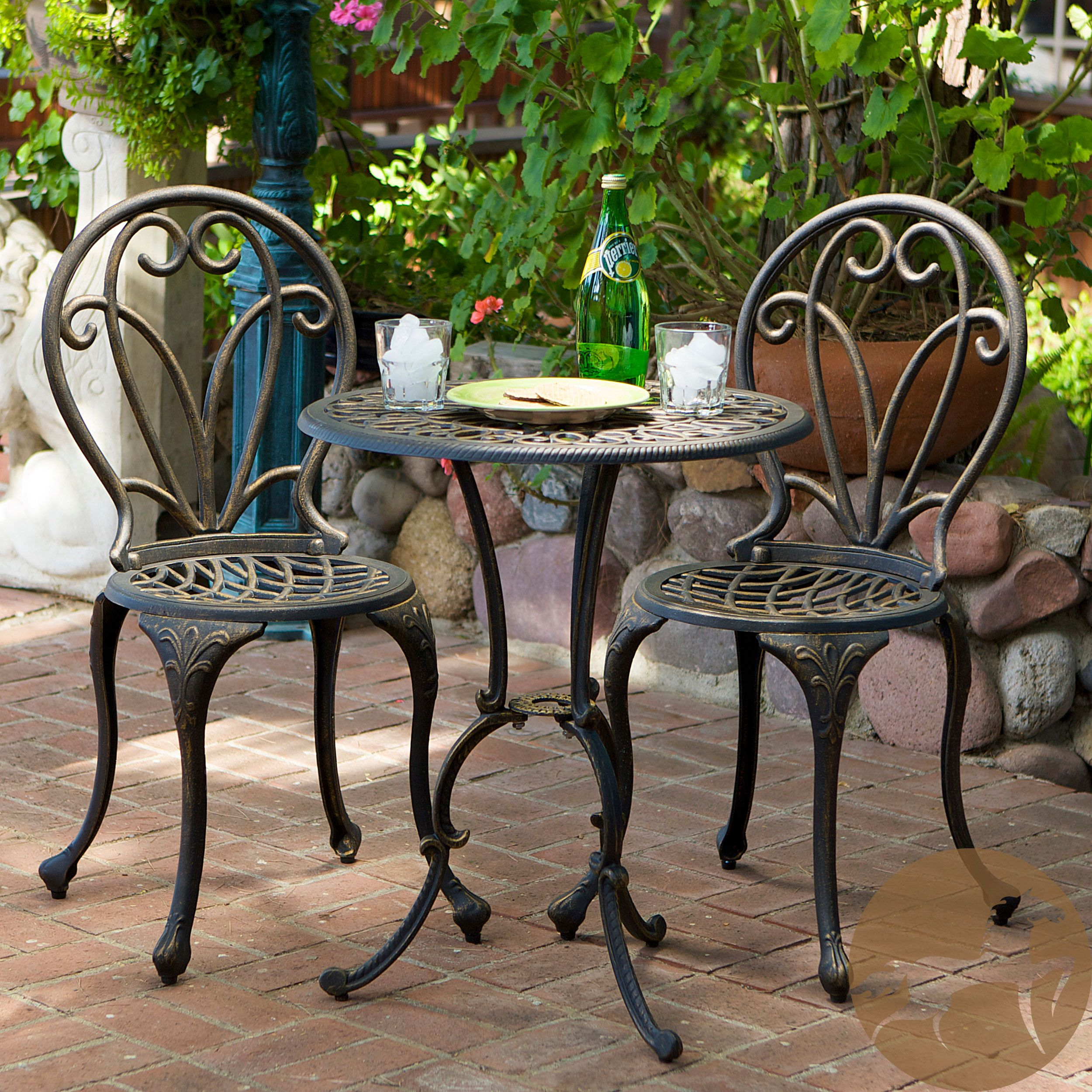 This French Style Outdoor Bistro Set Will Lend Cly To Your Patio The Is Constructed Of Cast Aluminum In Dark Gold Color With Iron Legs