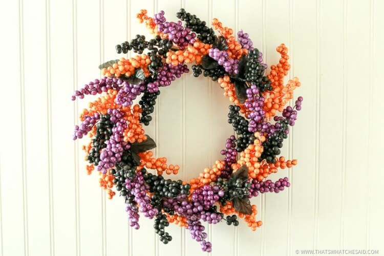 This easy berry Halloween Wreath is made from Dollar Store Supplies