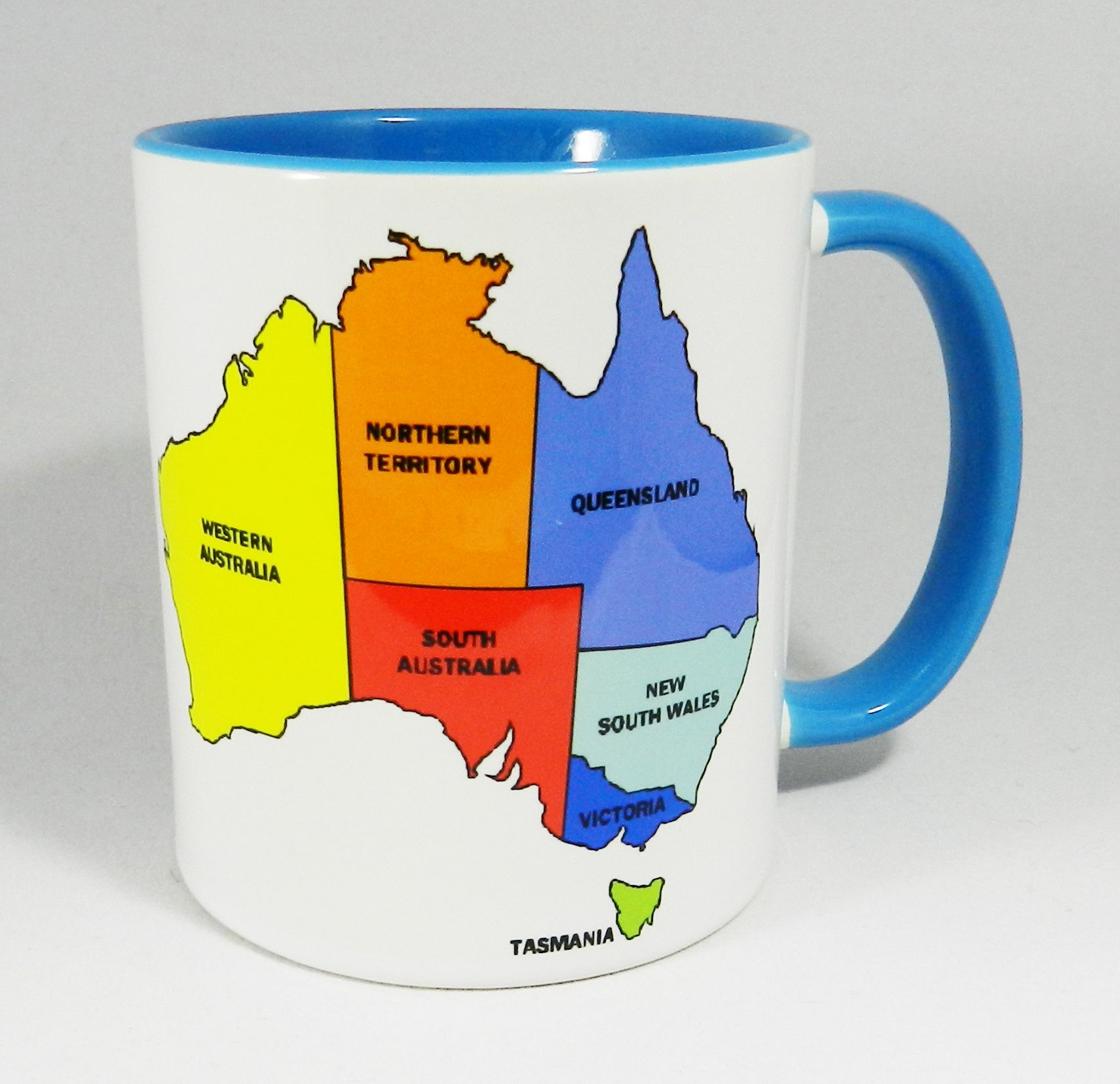Colourful map of Australia, showing 7 of the 8 States and territories that make up the Country. New South Wales, Victoria, Northern Territories, Queensland, South Australia, Tasmania and Western Australia. Designed and printed in Britain. A high quality ceramic mug which is both dishwasher and microwave proof. Blue Ceramic Mug with a glazed blue handle and inner. Height 9.5cm Diameter 8.2 cm Capacity is 310 ml (11oz). From the Series 10 Eductaional Range by Half a Donkey…