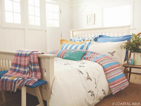 i like the mismatched bedding.