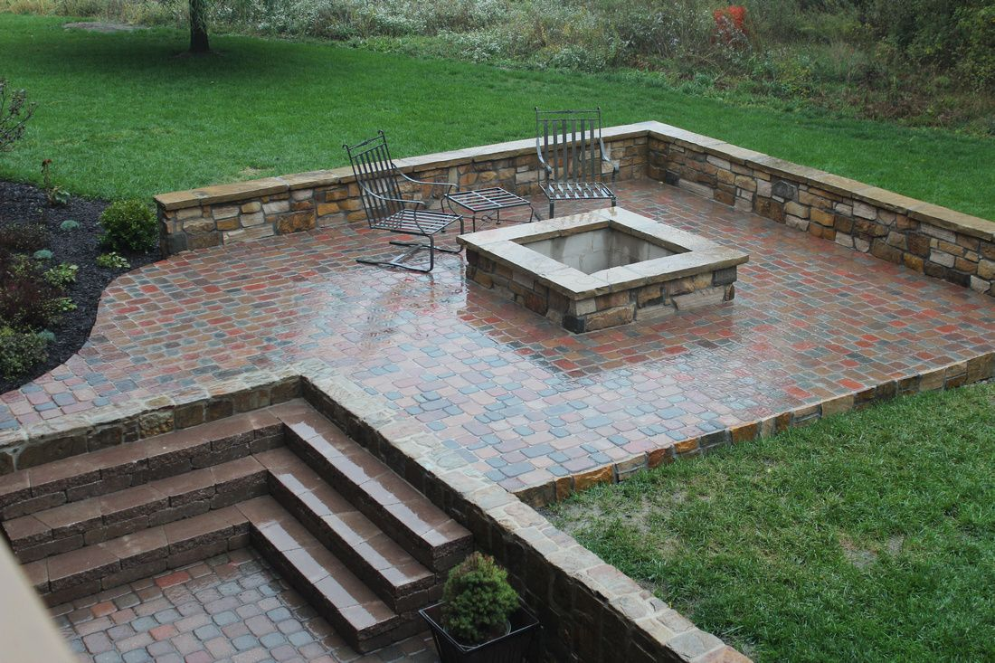 Awesome fire pit with built-in seating wall. Paver patio.