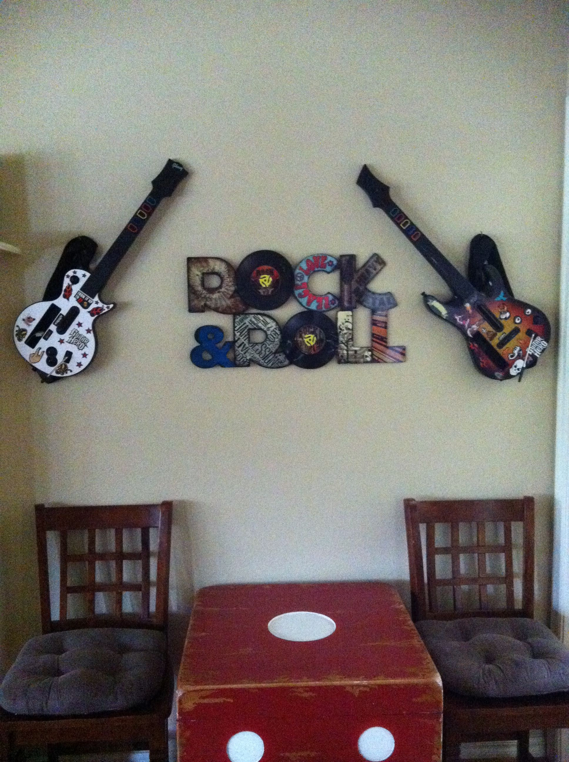 Store the Wii Guitar Hero on the wall. Great look and storage. (Just ...