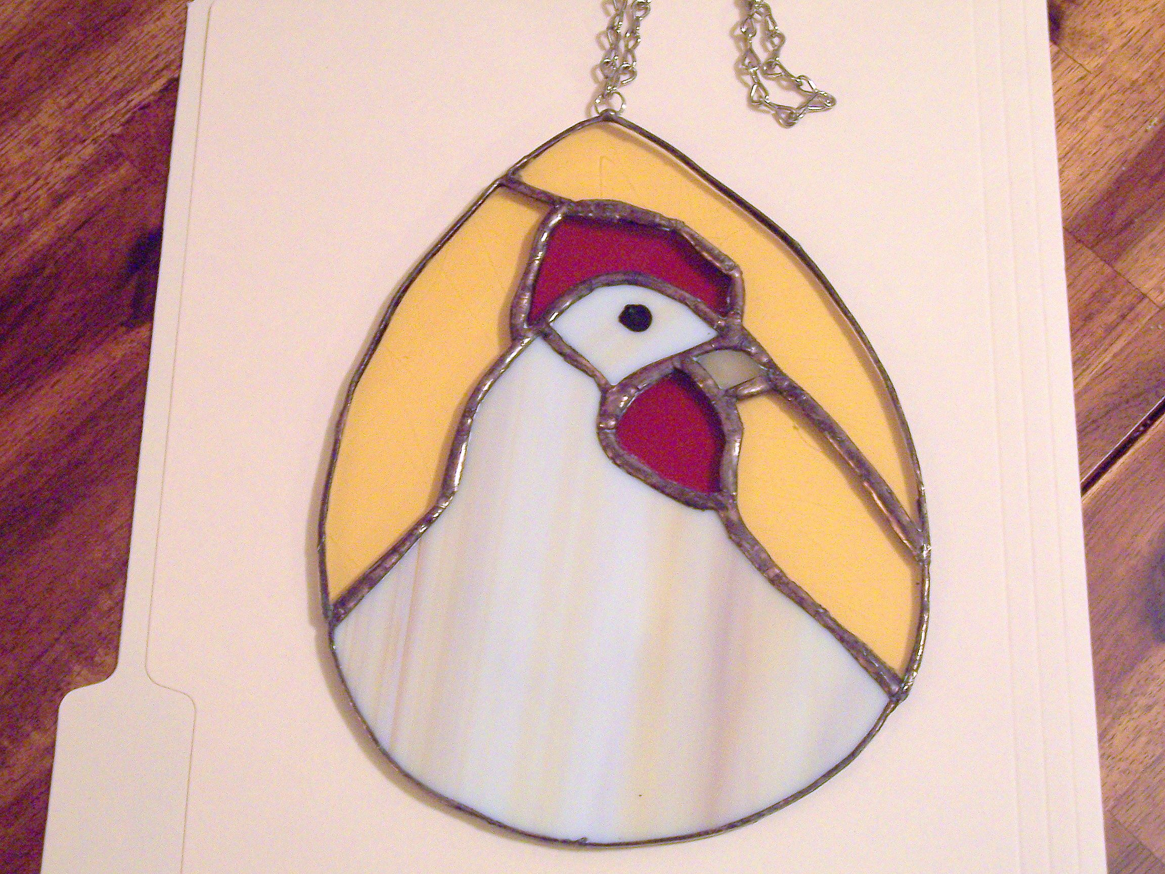 Hen in an Egg Suncatcher that I made for my shop on Etsy.com.  Please visit www.NancyBsStainedGlass.etsy.com