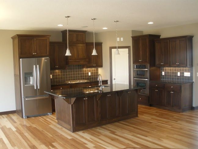 dark walnut kitchen cabinets hickory flooring in kitchen ldk kitchen featuring walnut 14491